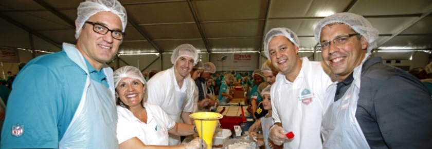 Miami Dolphins, AARP Pack Meals For Older South Floridians In Need