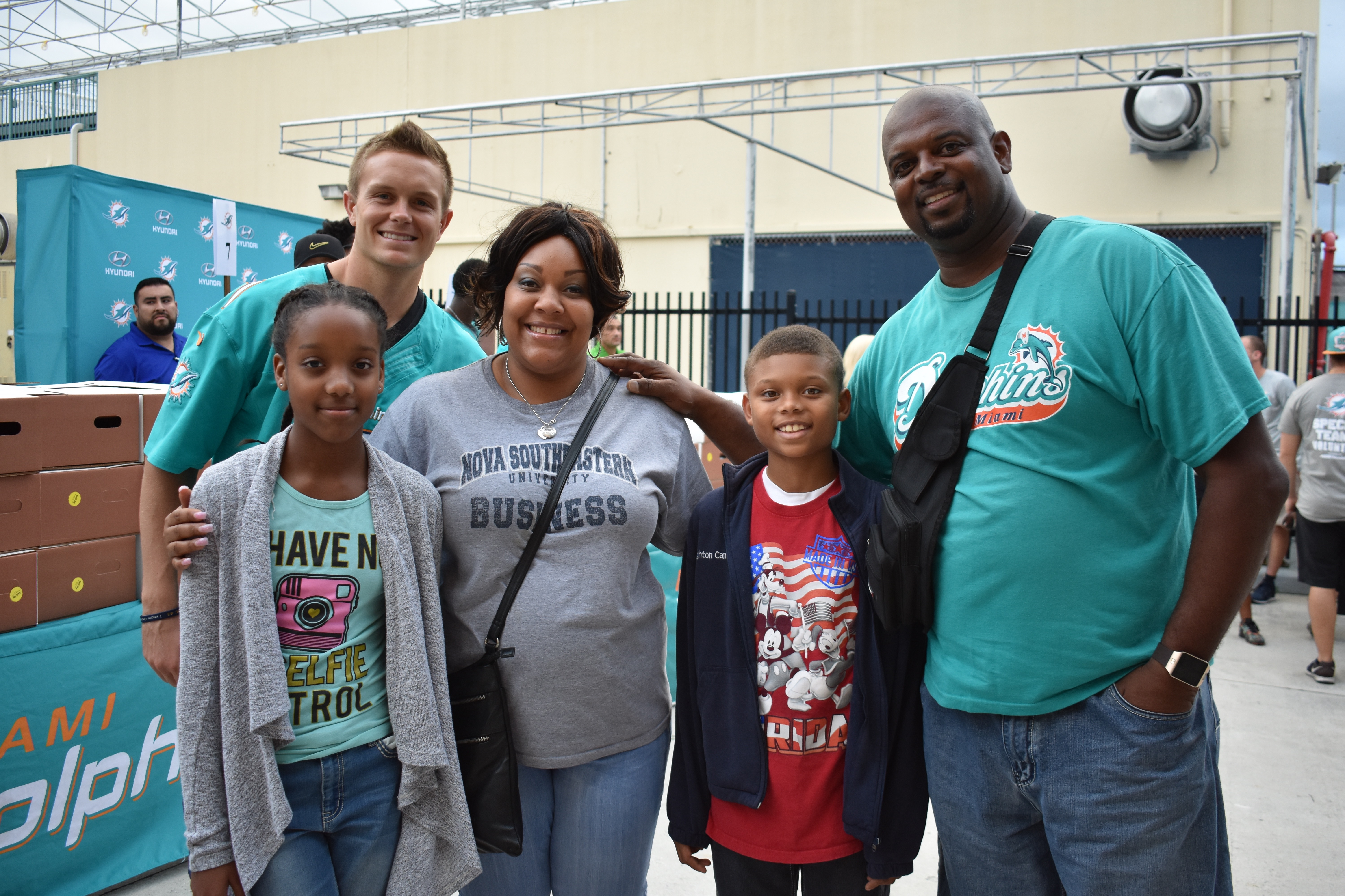 Dolphins Players, Coaches Hand Out 500 Thanksgiving Meals To Local Families