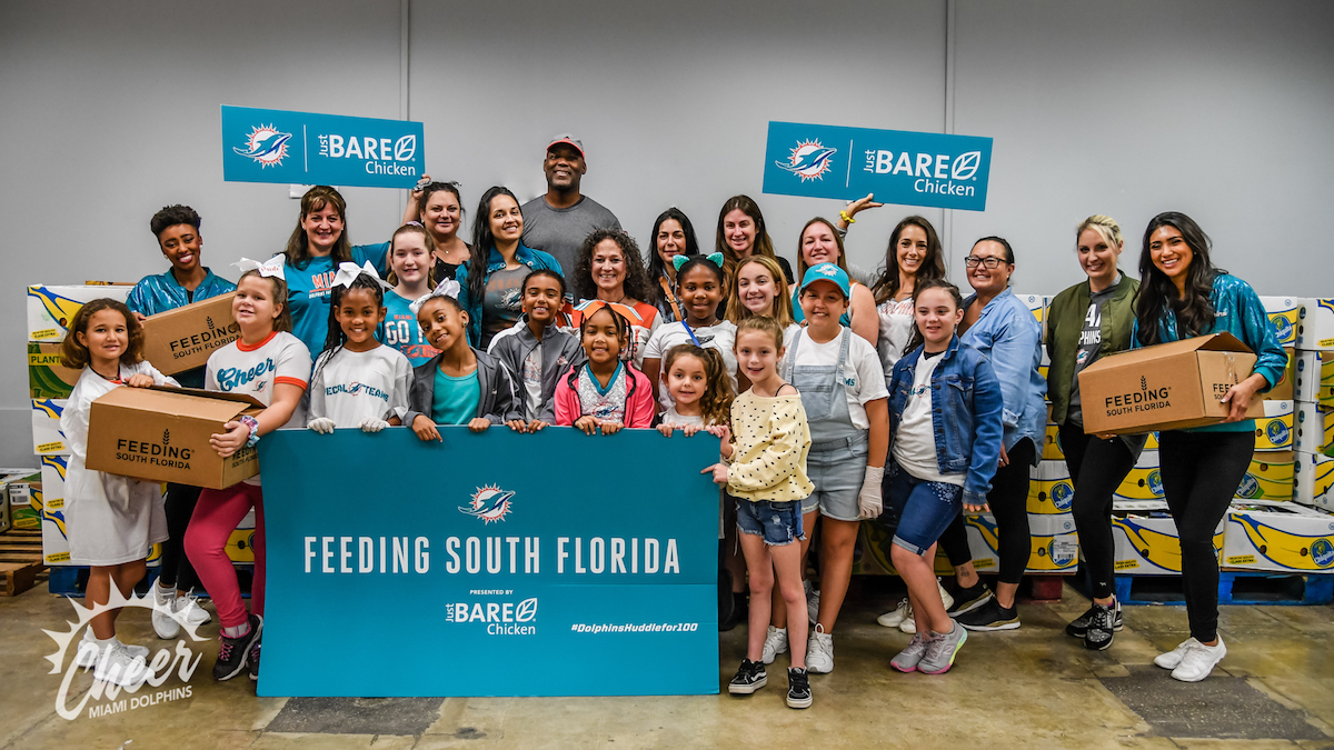 Dolphins Cheerleaders and Junior Cheerleaders in a #DolphinsHuddleFor100 Project