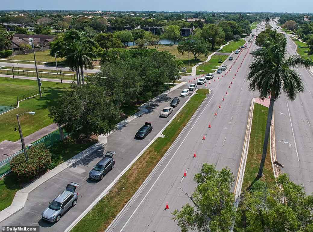 Startling drone footage shows 1.5 mile-long line of cars waiting outside a drive-thru food bank in Miami that gives out 2.5 million meals per week as coronavirus effects leave millions hungry