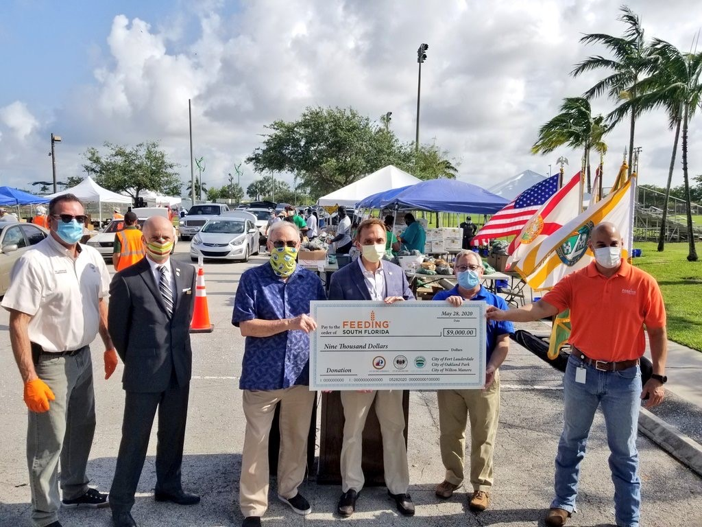 The Cities of Fort Lauderdale, Oakland Park, and Wilton Manors presented a joint check for $9,000 to Feeding South Florida.